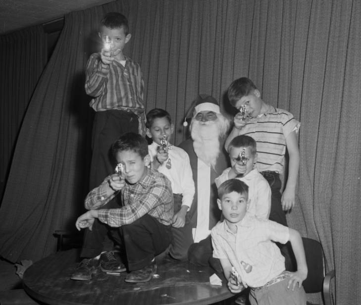 Boys with toy guns and Santa
