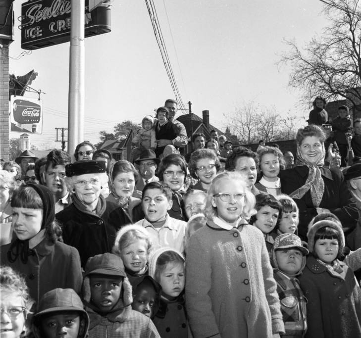 Crowd watching the Carillon Parade, 1956.