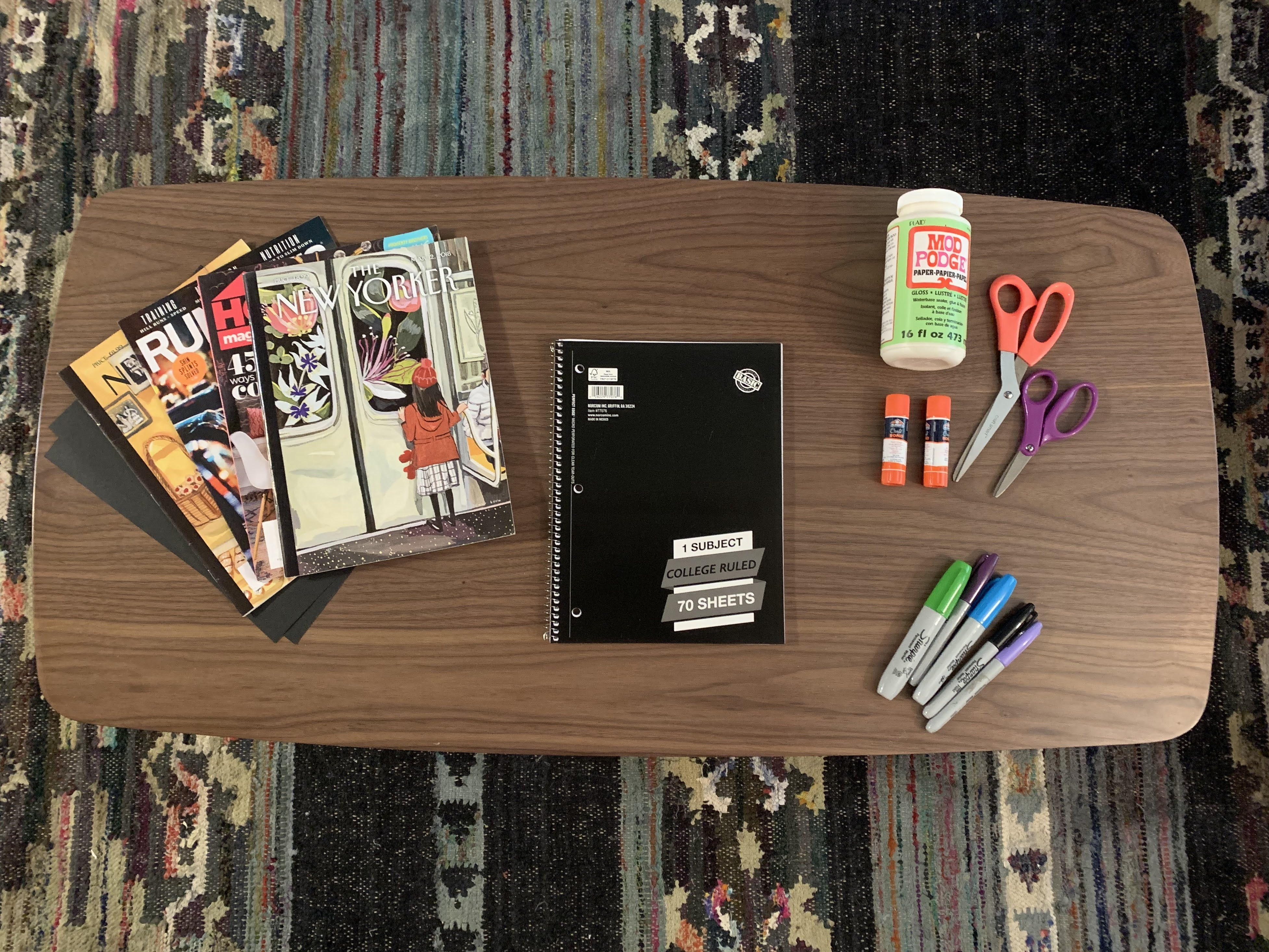 notebook and crafting supplies on a coffee table