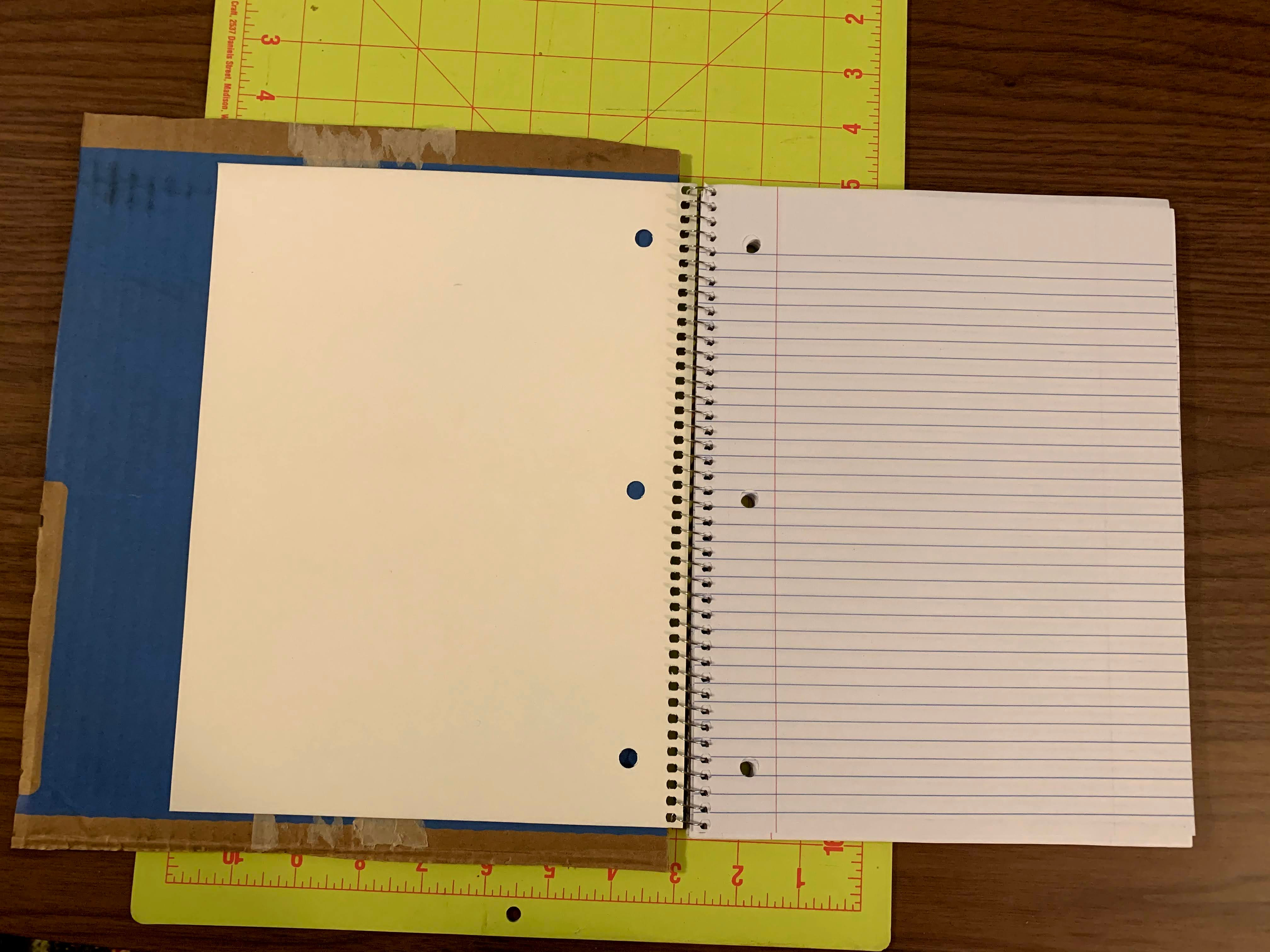 notebook open on cutting board