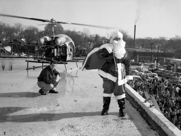 Santa arrives at Sears in a helicopter