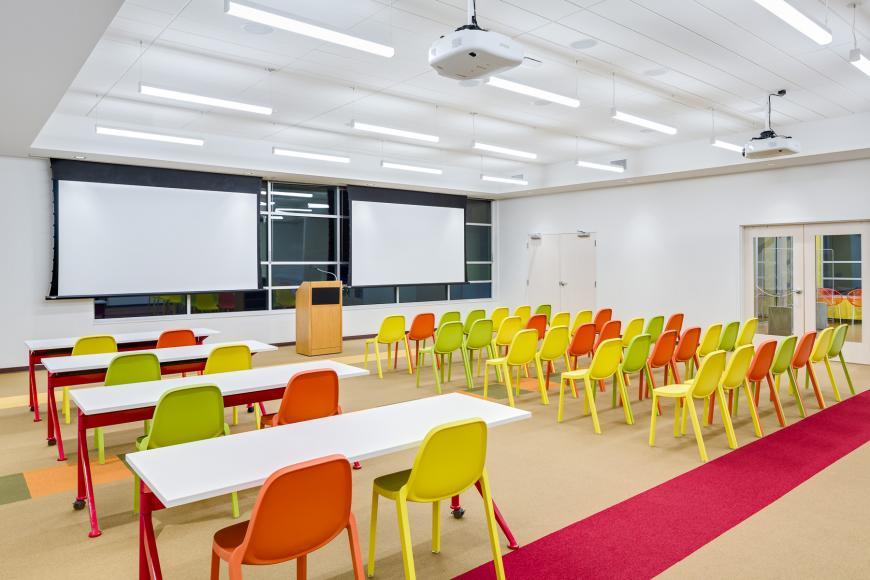 Large meeting room with 30 chairs and tables