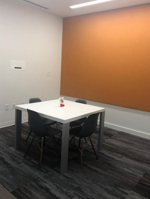 Small study room with four chairs and one table