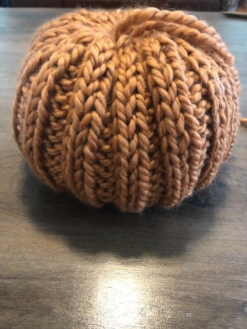 an almost finished 2x2 ribbed knit pumpkin