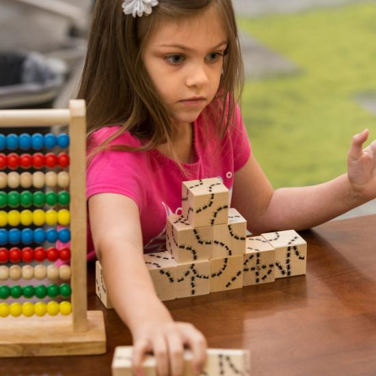 Girl building with blocks.