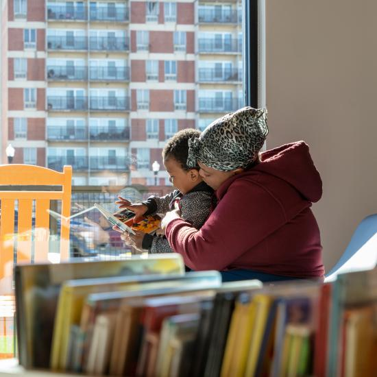 Mother reading to child at Richland Library Edgewood