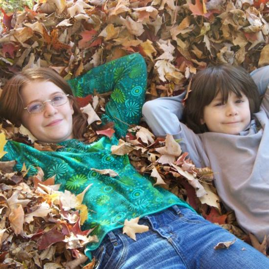 Children in the fall leaves