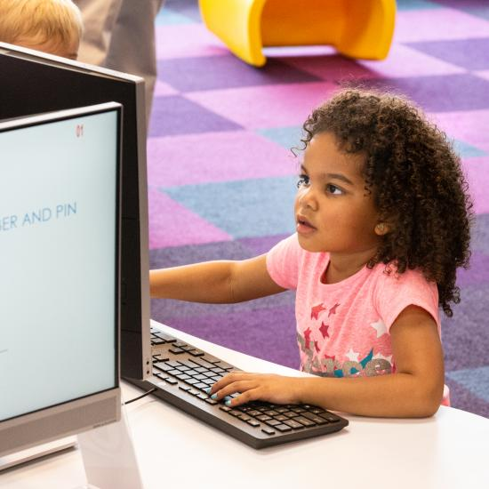 Child uses the library computer