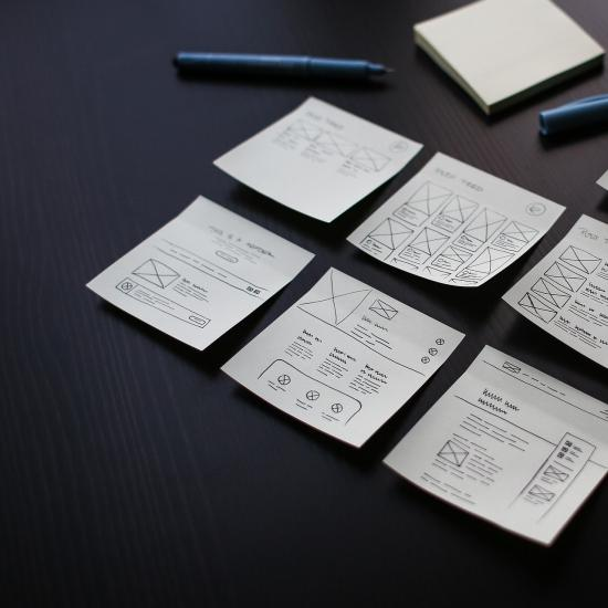 Sheets of paper with hand-drawn words and graphs