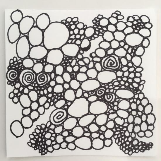 Black ink drawing of many varied circles.