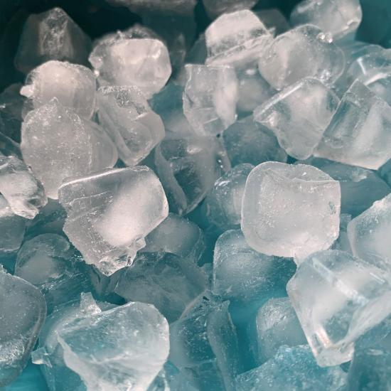 close up of ice cubes in a bowl
