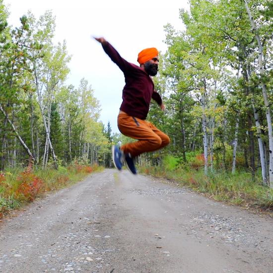 Picture of Gurdeep Pandher | Photo of a man wearing a turban leaping into the air