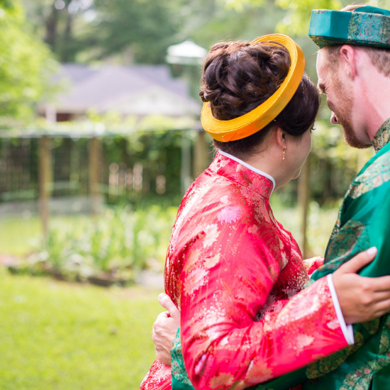 a couple in traditional Vietnamese wedding attire
